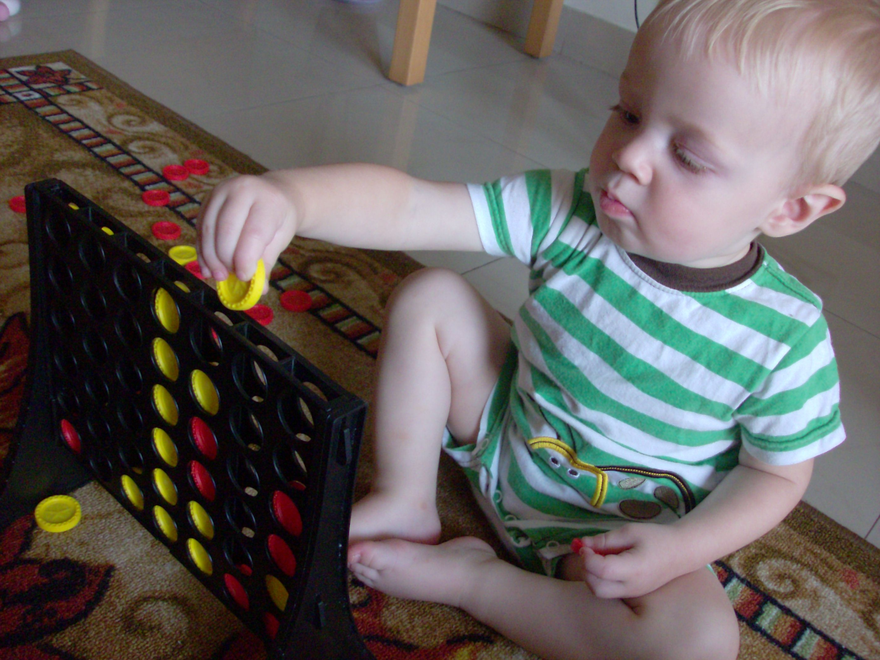 Baby playing connect 4