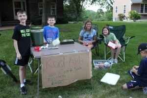 kids and money lemonade stand